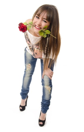 Sexy and funny girl bites a rose  photo
