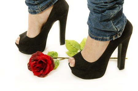 foot fetish: Jeans, heels and rose  Stock Photo