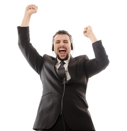 Excited suit man with headphones.