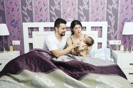 latin family: Young family in bedroom Stock Photo