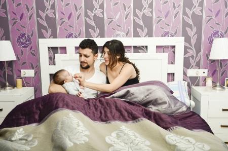 appease: Novice family in bedroom Stock Photo