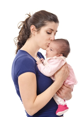 causal: Mum kissing newborn  isolated over white  Stock Photo