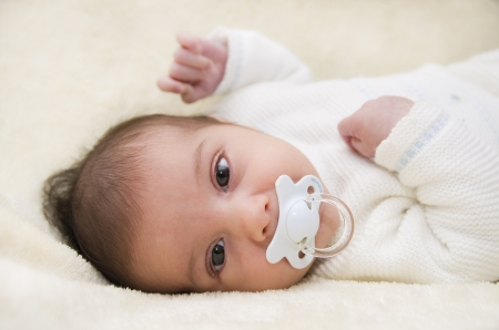 slanted: Cute baby with pacifier  Stock Photo
