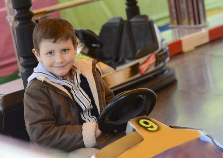 Bumper cars and young child Stock Photo