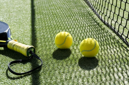 tennis court: Paddle tennis objects and sunlight shadow