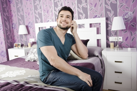 named person: Phone call in bedroom Stock Photo