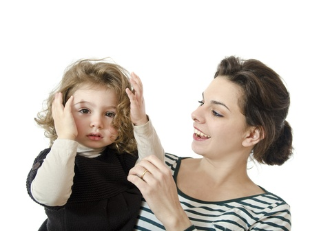 combing hair: Mom and little girl