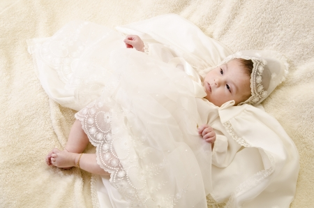Baby and ceremonial clothes Stock Photo