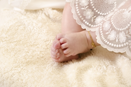 christening: Baby feet