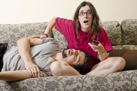 he and she: she excitedly watching TV, he slept