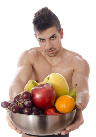 advised: Man in good physical shape you are advised to eat fruit  Stock Photo