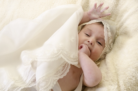 liying: Baby with ceremonial clothes Stock Photo