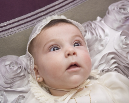 baptize: Portrait of baby with christening cap