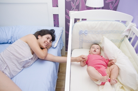Mother and baby together in the bedroom  Stock Photo