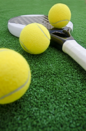 Paddle tennis wide angle objects on turf Stock Photo