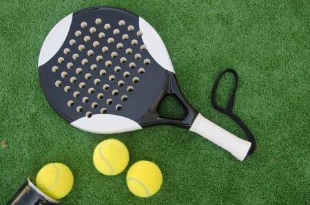 Paddle tennis objects on grass court Reklamní fotografie - 20702477