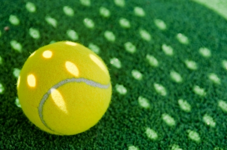 tennis: Shadow of paddle tennis racket