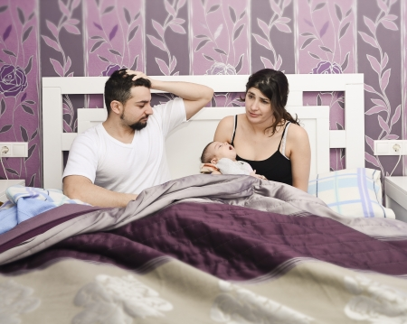 Tired parents with newborn
