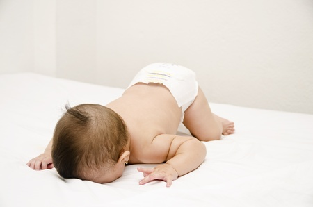 Face down lying baby photo