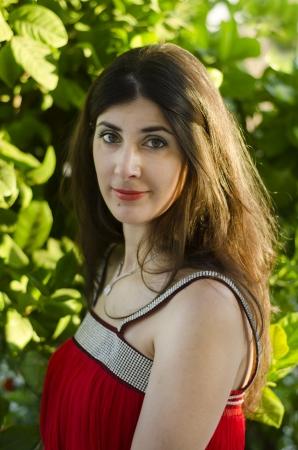 smirking: Smirking girl posing outdoors