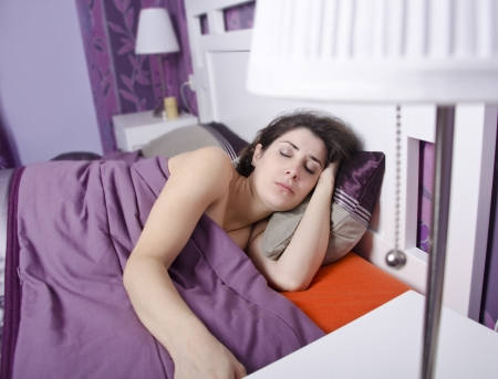 Woman sleeping alone in home bedroom Stock Photo - 21897113