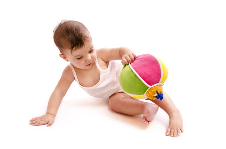 Isolated baby playing with ball on white backgrouund photo