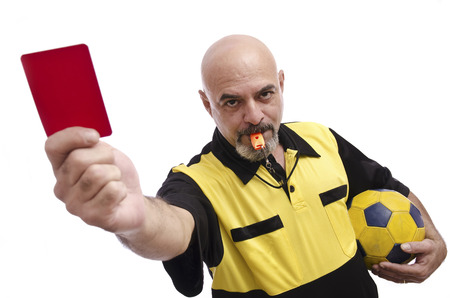 ref: Isolated referee showing red card at the view  Stock Photo