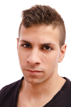 plucked: portrait of a metrosexual guy with modern hairstyle and eyebrows plucked. Stock Photo