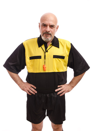 ref: Isolated mature referee posing on white background Stock Photo