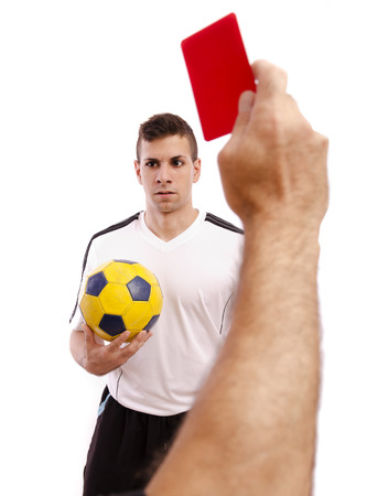 Referee show red card to soccer player, isolated on white. photo