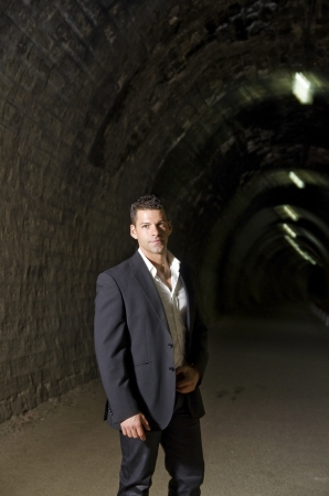 Suit man in black tunnel posing photo