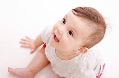 baby sit: Smiling baby looking out of frame  Sit on floor
