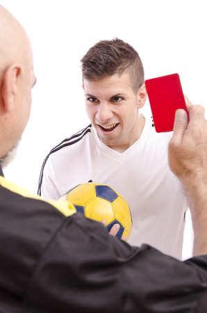 ref: Soccer referee show red card to young angry player