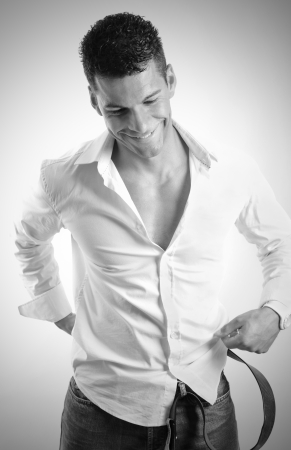 undressing: Man dressing in monochrome, closeup portrait