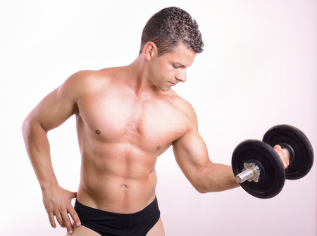 pectorals: Lifting weights tough guy on gray background