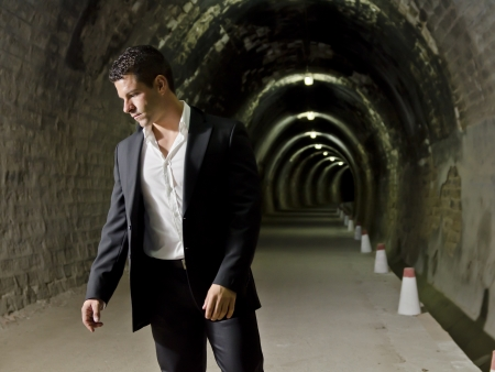 Suit man in tunnel photo