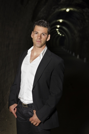 Suit elegant man in tunnel portrait. photo