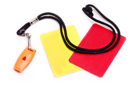 ref: Red and yellow card with whistle isolated on white Stock Photo