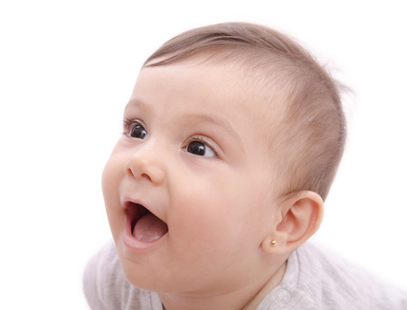 baby gesicht: Nettes l�chelndes Baby mit dem Gesicht Portr�t auf wei� Lizenzfreie Bilder