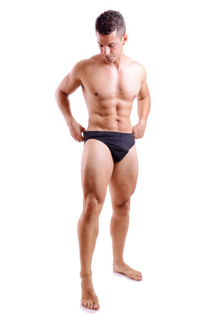 leg: Isolated full length portrait of strong man in underwear