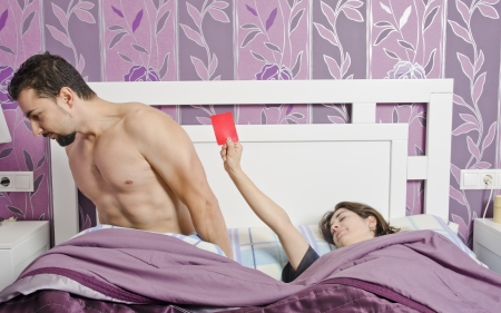 Conceptual image , woman with red card  Concept of sex rejection or menstruation  Stock Photo