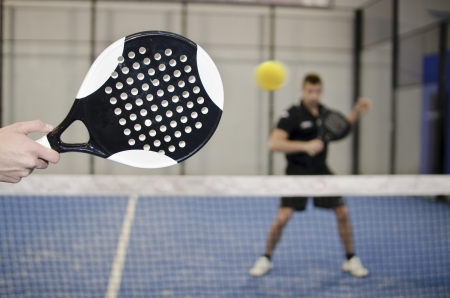 Paddle tennis copuple playing in court with ball Stock Photo