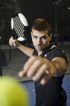 Paddle tennis player ready for ball shot photo