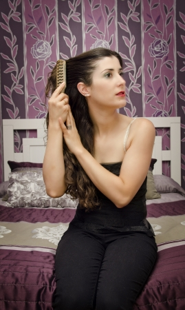 vignetting: vintage vignetting combing hair gril portrait in bedroom
