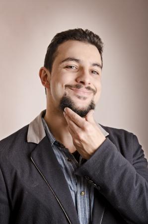 Man with goatee portrait, touching chin Stock Photo