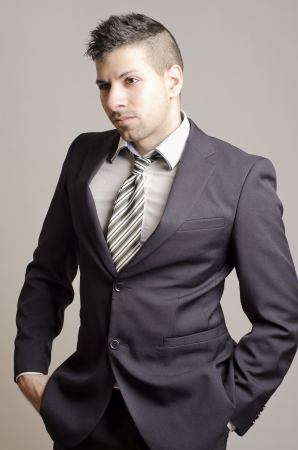 Image of young and modern businessman in studio shot photo
