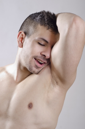 axilla: Sexy young man portrait showing his biceps