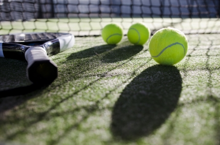 paddle tennis objects on artificial turf ready for tournament with hard dramatic shadows  Stock Photo