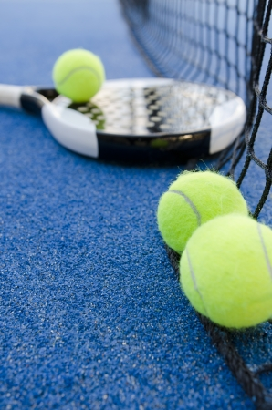 paddle tennis objects on artificial turf ready for tournament, focus in second ball Stock Photo