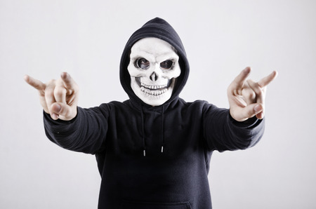 Man with skull costume and horned hand with Sweatshirt